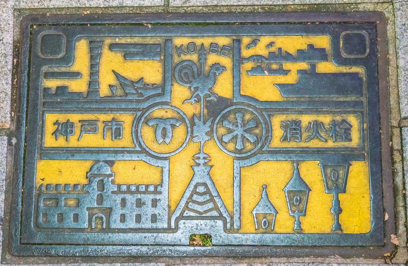 Kobe, Hyogo Prefecture, Kansai region, Japan - NOV 20, 2016 - Fi. Re hydrant cover on floor at Motomachi shopping street in Kobe, Japan stock image
