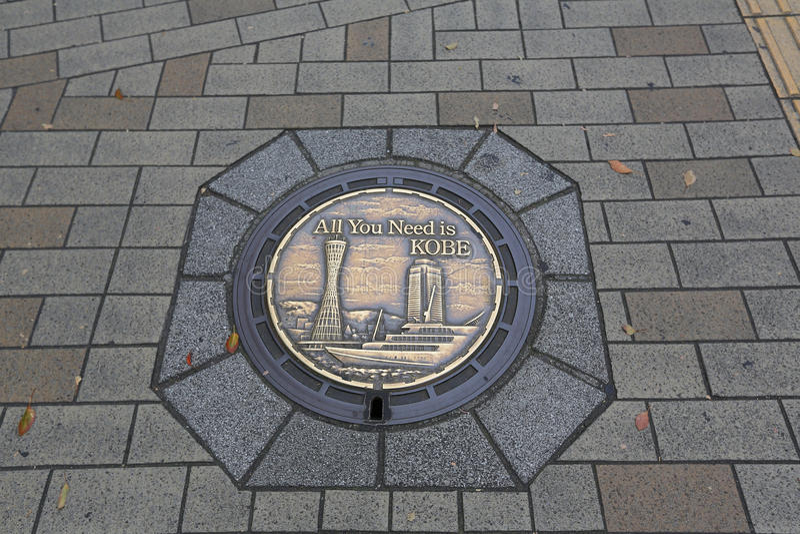 Kobe Street regnvatten för manhålräkning royaltyfri fotografi