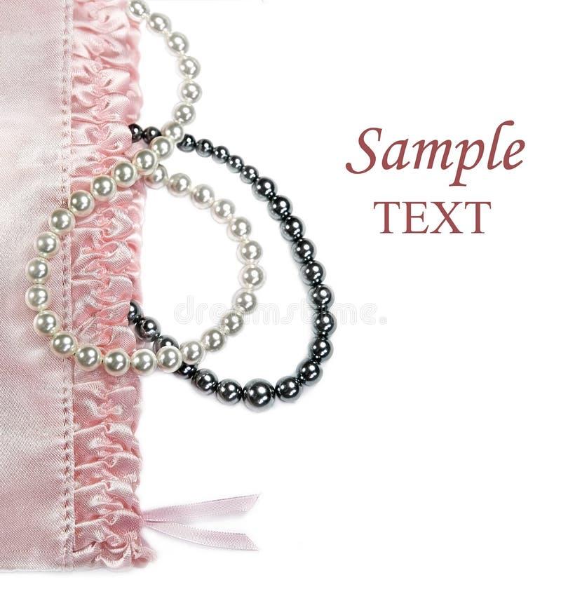 kobiecych pereł różowy położenie obraz stock