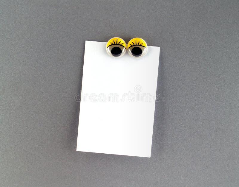 Kobiet oczu fridge magnes i puste miejsce notatka obrazy stock