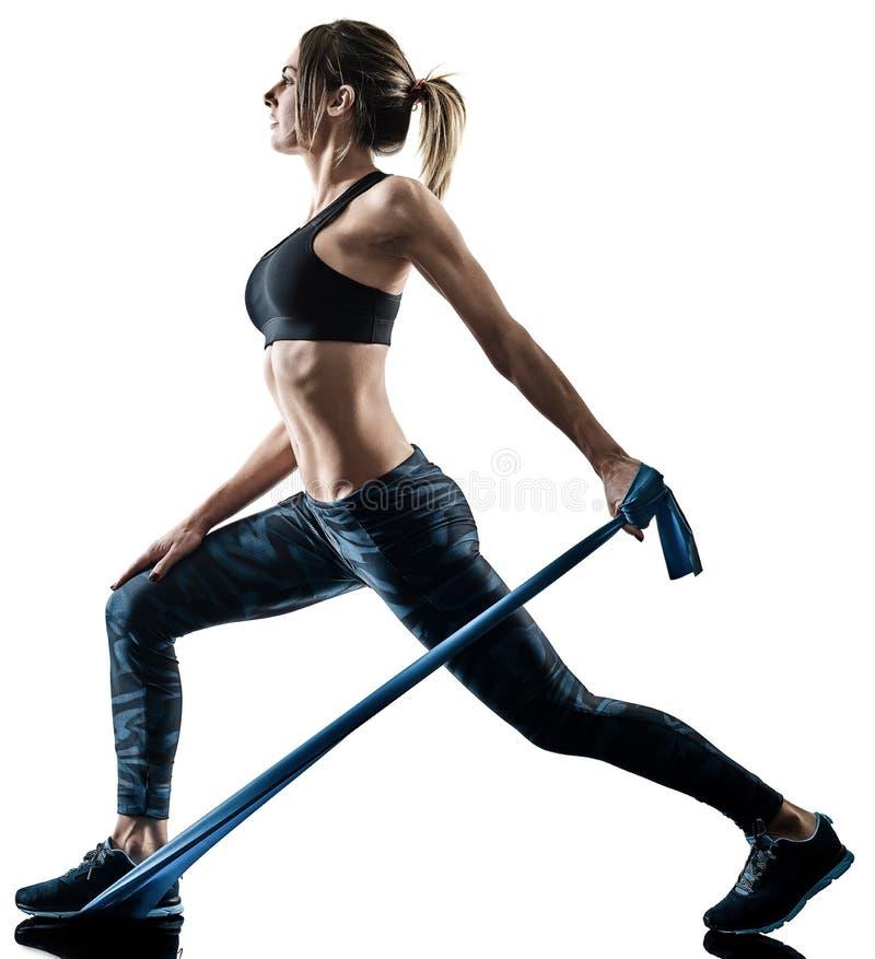 Kobiet pilates sprawno?ci fizycznej elastyczny odporny zesp?? ?wiczy silhouett fotografia royalty free
