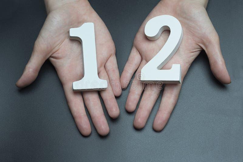 Kobiet ręki numerowi dwanaście obrazy royalty free