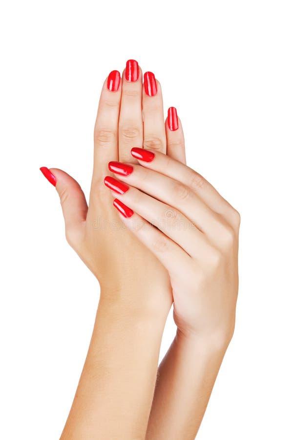 Kobiet ręki z czerwonymi gwoździami obraz stock