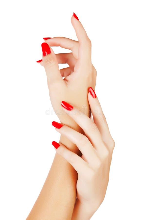 Kobiet ręki z czerwonymi gwoździami obrazy stock