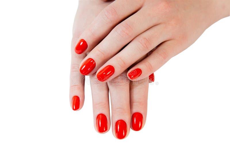 Kobiet ręki z czerwonymi gwoździami, odosobnionymi na bielu zdjęcia stock