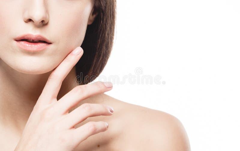 Kobiet ramion wargi wręczają palca zakończenia portret fotografia stock