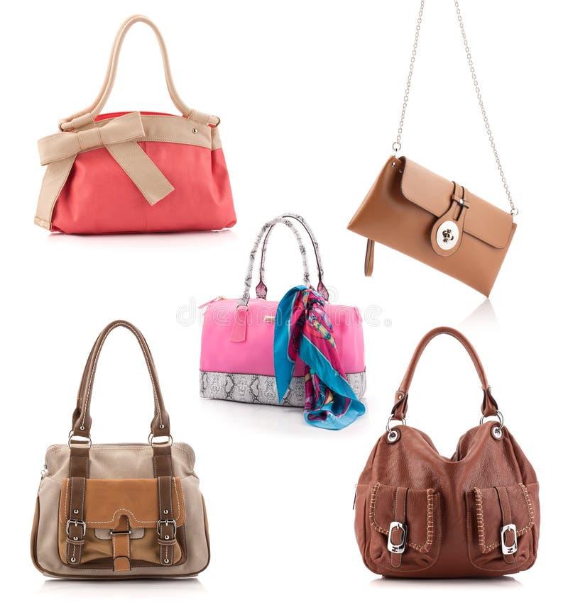 Kobiet rzemienne torby ustawiać odizolowywać na bielu obrazy stock