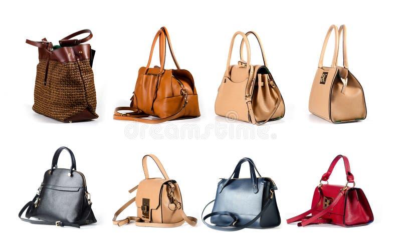 Kobiet rzemienne torebki odizolowywać na białym tle fotografia stock