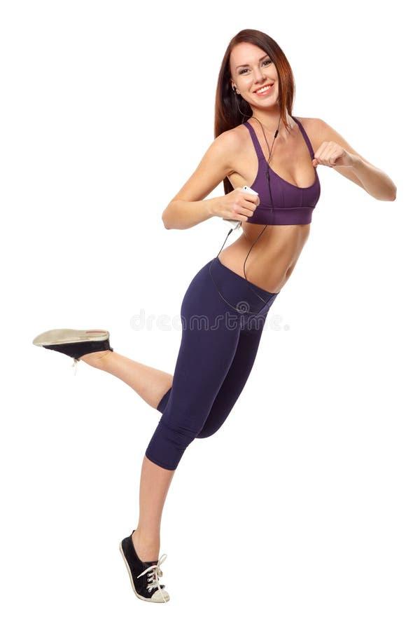 Kobieta bieg na bielu z hełmofonami telefon zdjęcia stock
