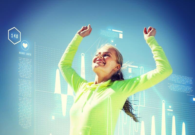 Kobieta biegacza odświętności zwycięstwo fotografia stock