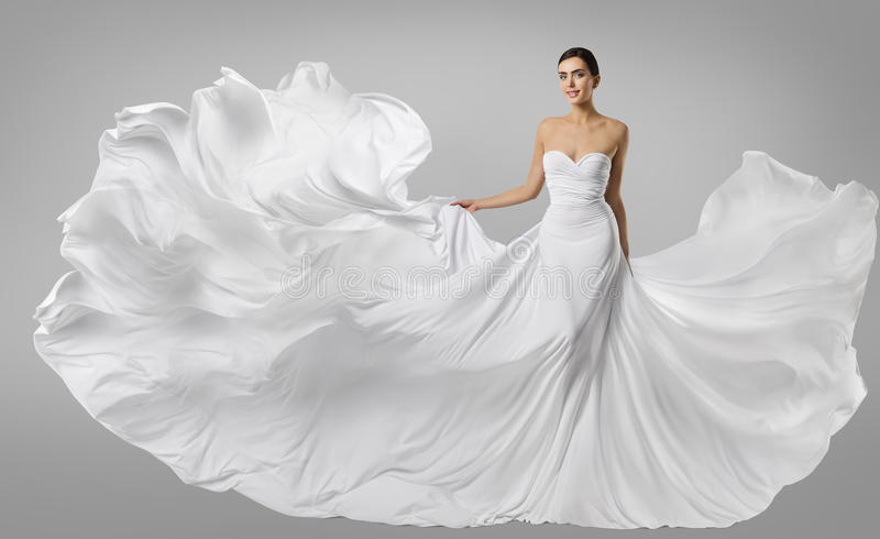 Kobieta bielu suknia, moda model w Długiej Jedwabniczej todze, Macha płótno obrazy stock