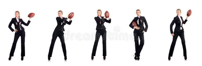 Kobieta bizneswoman z futbolem amerykańskim obraz royalty free