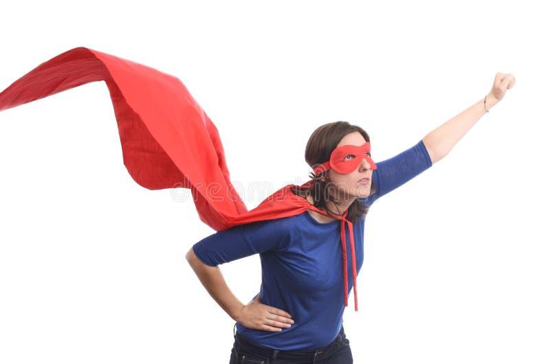 Kobieta bohater z czerwonym przylądkiem, odizolowywającym zdjęcie stock