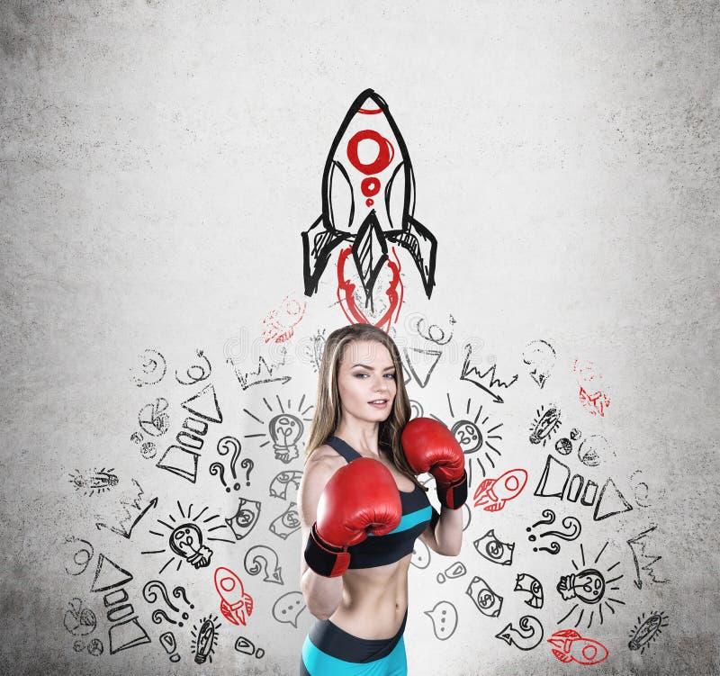 Kobieta bokser i rakieta obrazy stock