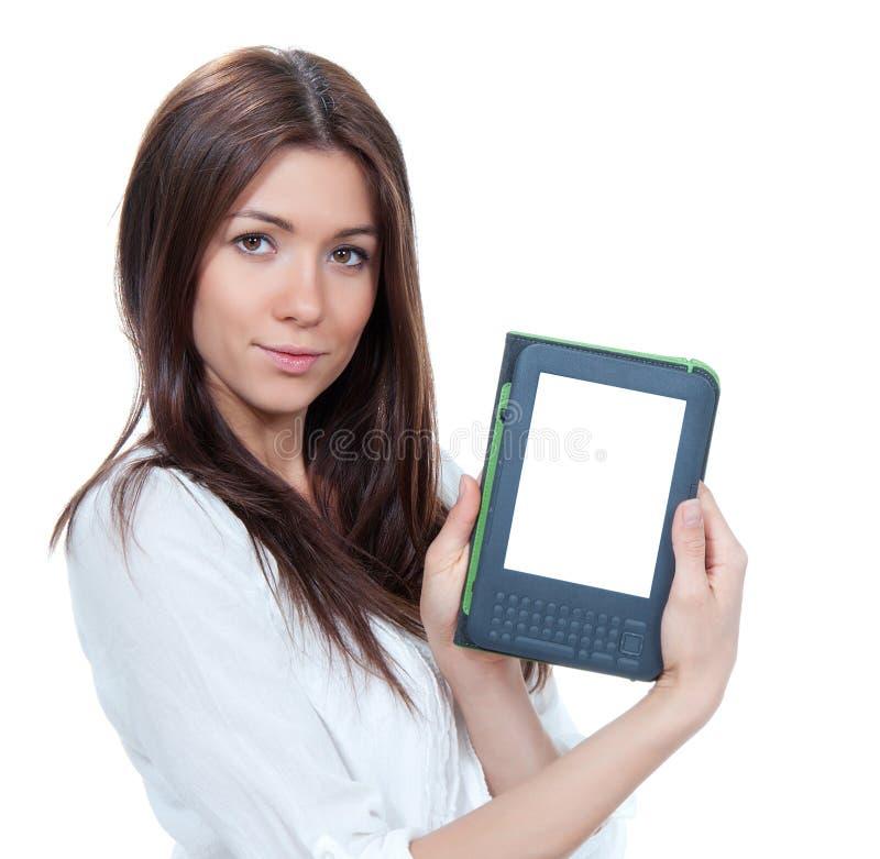 Kobieta chwyta elektronicznej książkowej pastylki czytelniczy przyrząd zdjęcie royalty free