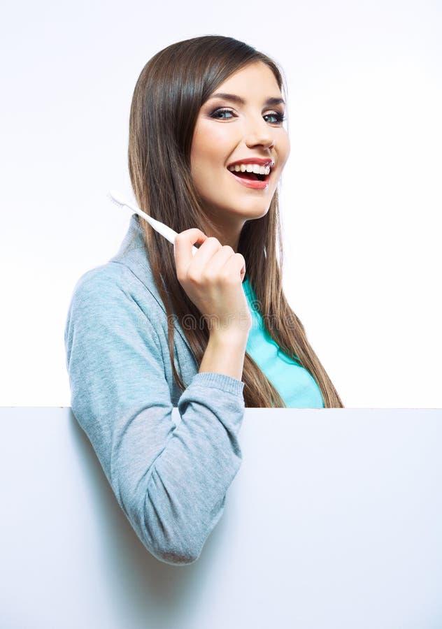 Kobieta chwyta toothbrush odizolowywający na białym tle. obrazy royalty free