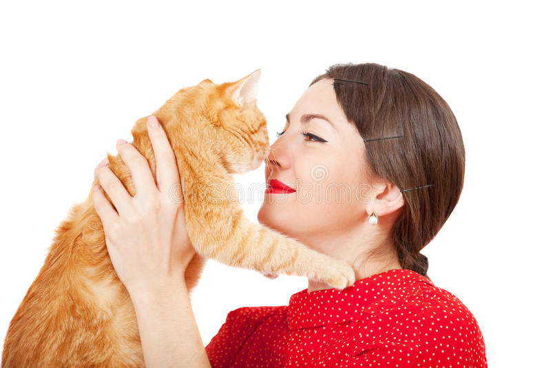 Kobieta chwyty w ręki czerwieni kocie zdjęcia stock