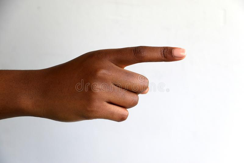 Kobieta, czarny afrykanin r?ki indyjski wskazywa? obraz stock