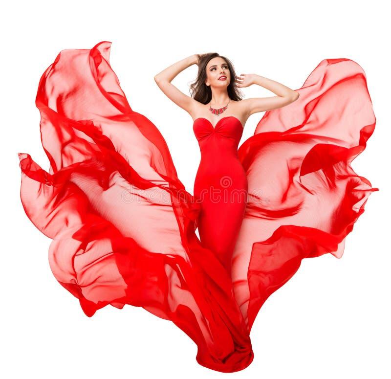 Kobieta Czerwona Jedwabna Sukienka na wietrze, piękno modelu mody, dmuchające mur fotografia royalty free