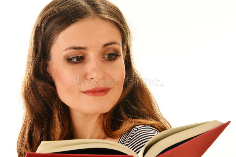 Kobieta czyta książkę. Żeńskiego ucznia uczenie obrazy royalty free