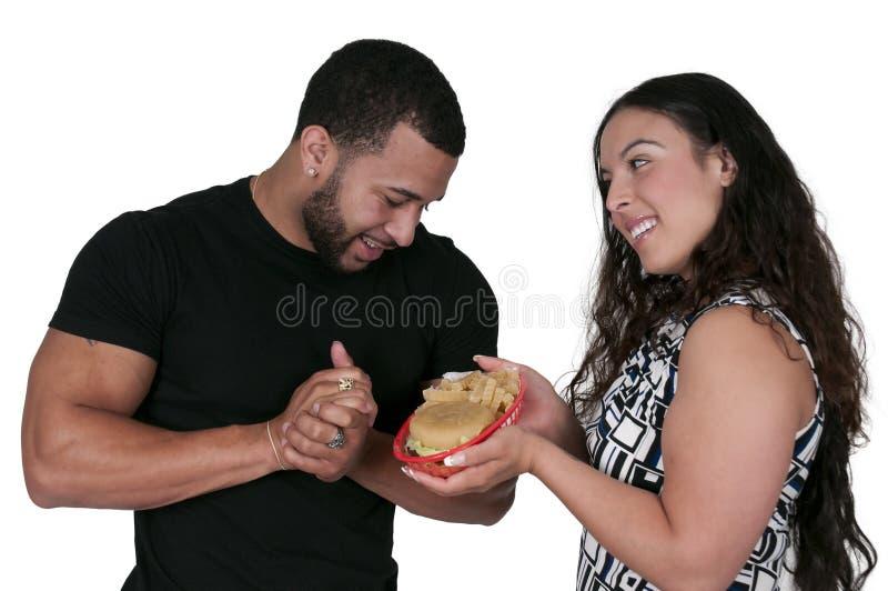 Kobieta Daje hamburgerowi mężczyzna obrazy royalty free