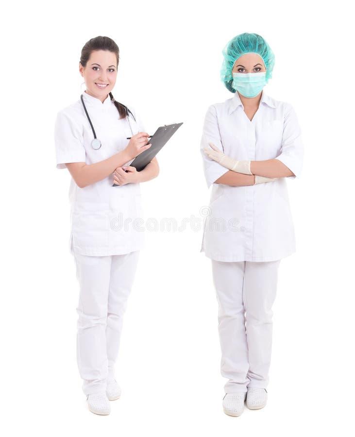Kobieta doktorska i pielęgniarka stoi nad bielem zdjęcie stock