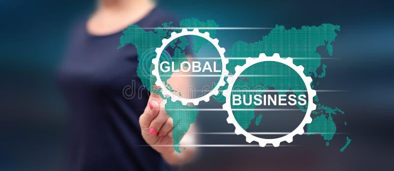 Kobieta dotyka globalnego biznesu pojęcie zdjęcia stock