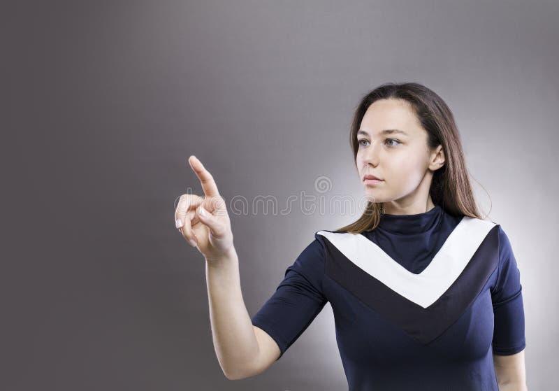 Kobieta dotyka wirtualnego interfejs obraz royalty free