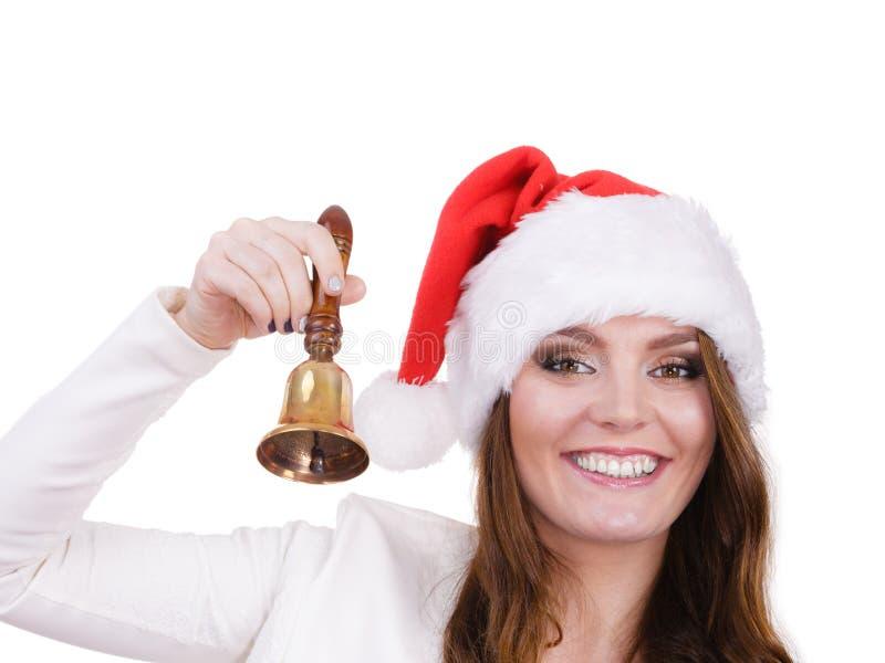 Kobieta dzwoni dzwon w Santa Claus kapeluszu obraz royalty free