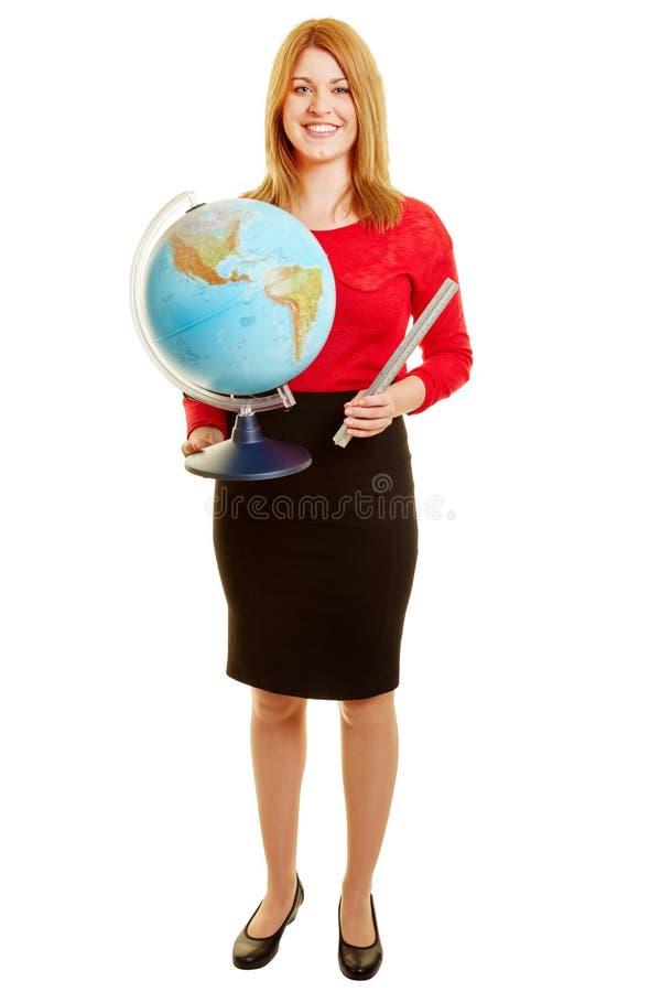 Kobieta jako nauczyciel z kulą ziemską zdjęcia royalty free
