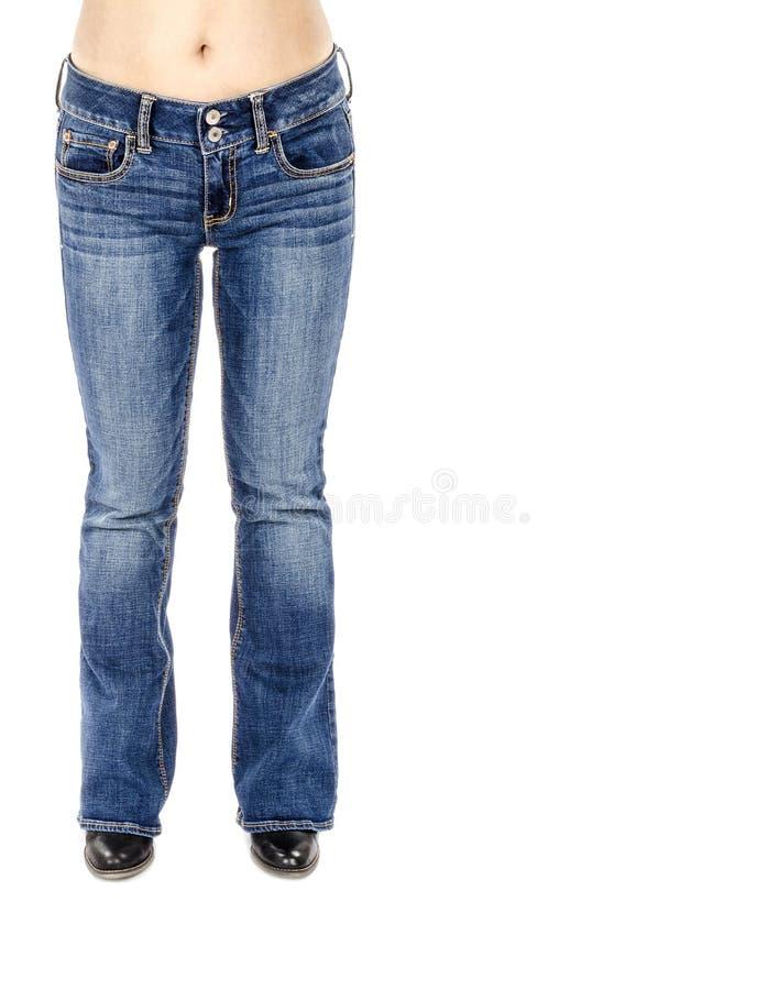 Kobieta Jest ubranym Migoczących niebieskich dżinsy i Czarną kostkę Inicjuje -1 obrazy stock