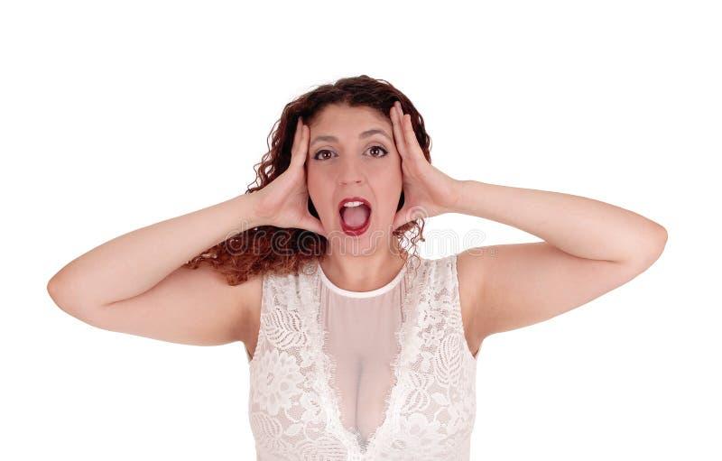 Kobieta krzyczy, ręki na głowie zdjęcia stock