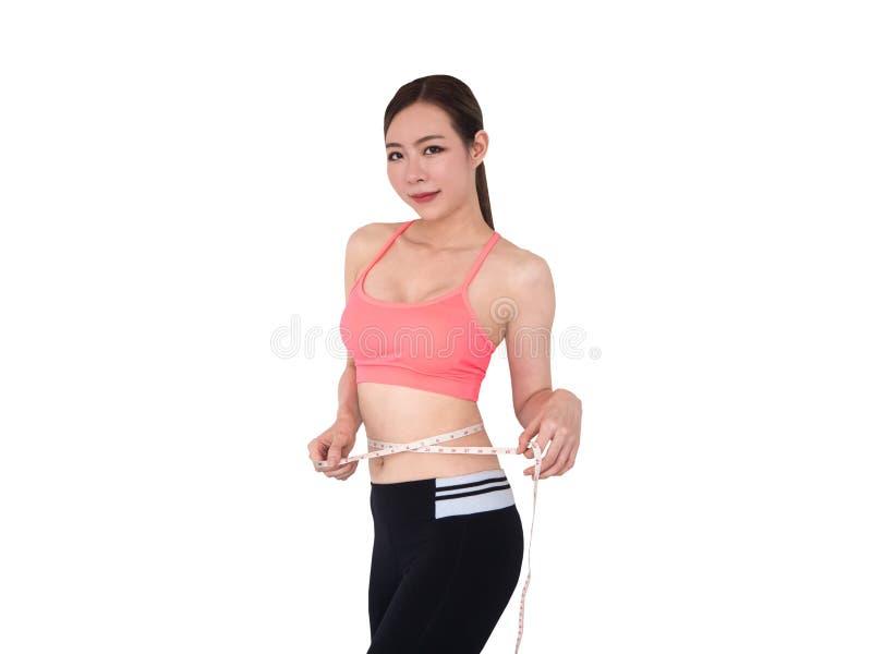 Kobieta mierzy jej ciała, sport dziewczyna, odizolowywająca na białym tle fotografia stock