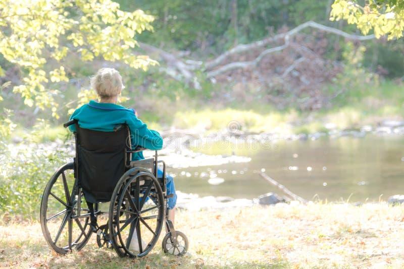 Kobieta na weelchair fotografia stock