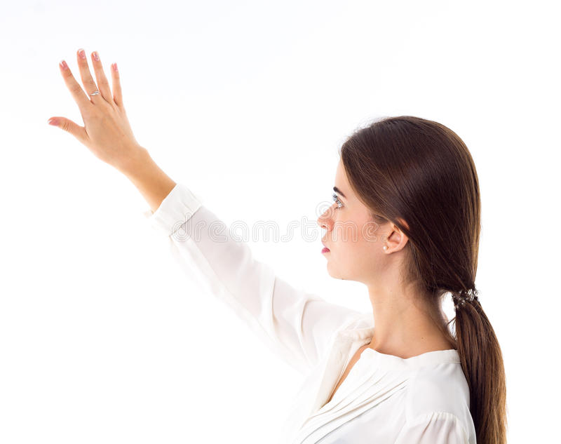 Kobieta patrzeje jej rękę zdjęcie stock