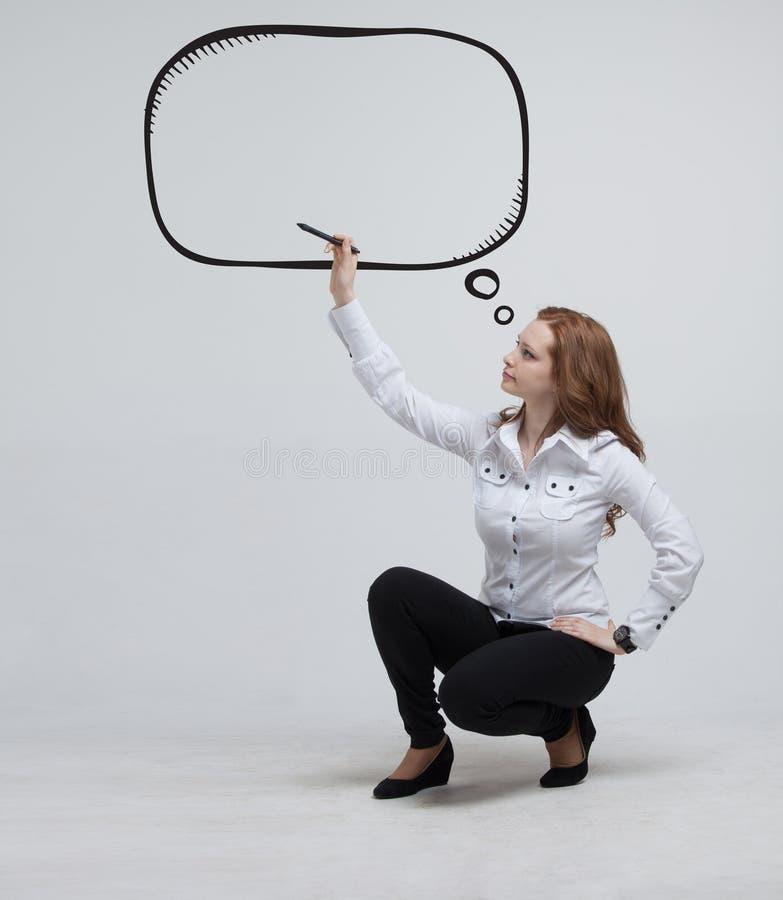 Kobieta pisze w malującej mowy chmurze obraz royalty free