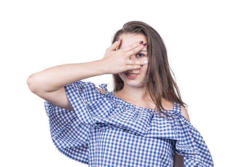 Kobieta podpatruje przez jej palców fotografia stock