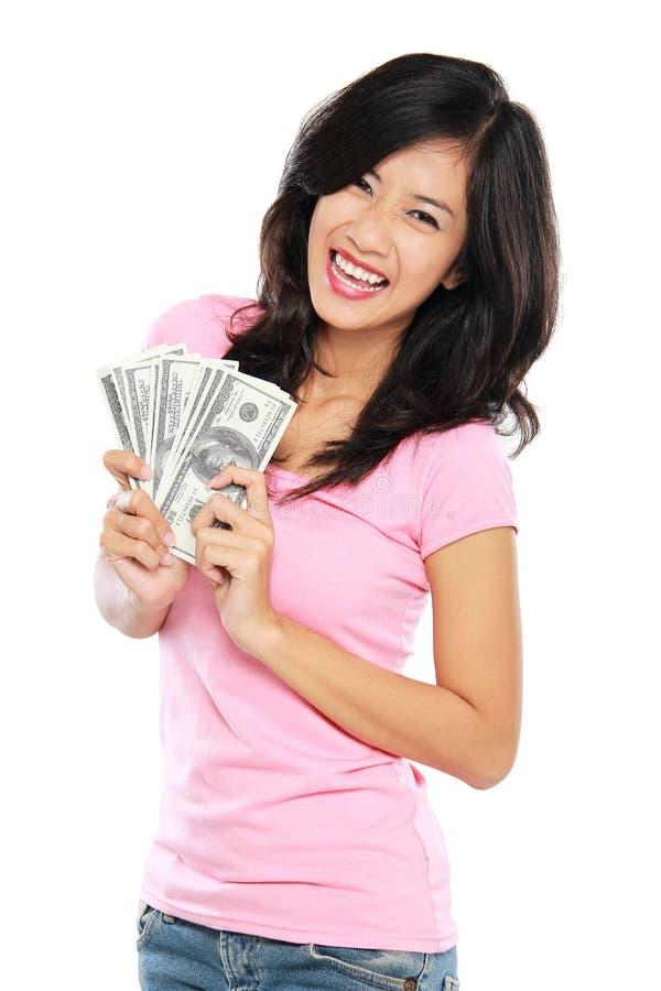 Kobieta pokazuje pieniądze odizolowywającego na białym tle obrazy stock