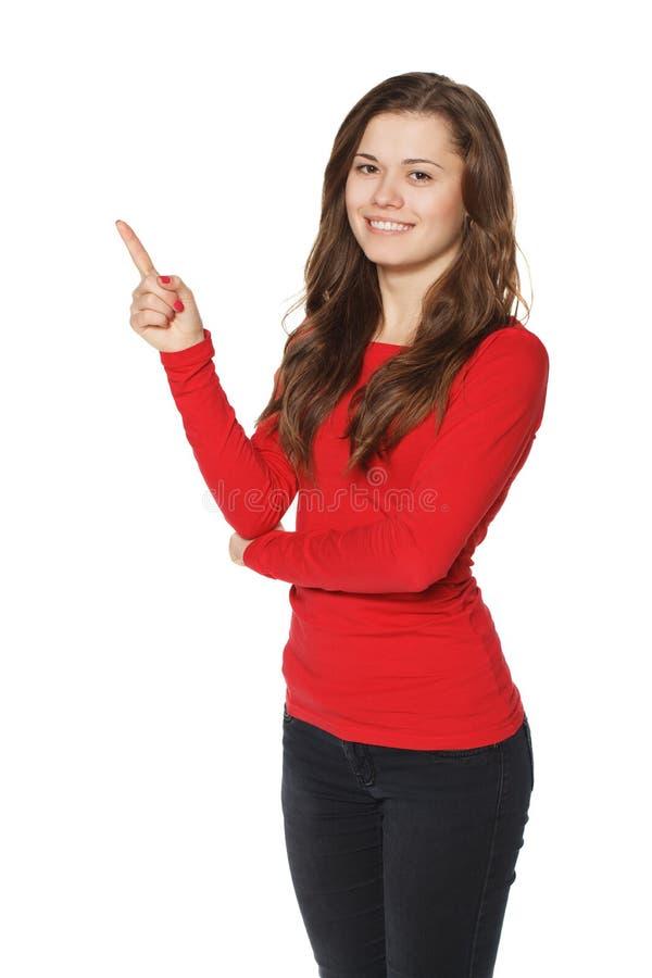 Kobieta pokazuje wskazywać i ono uśmiecha się obraz royalty free