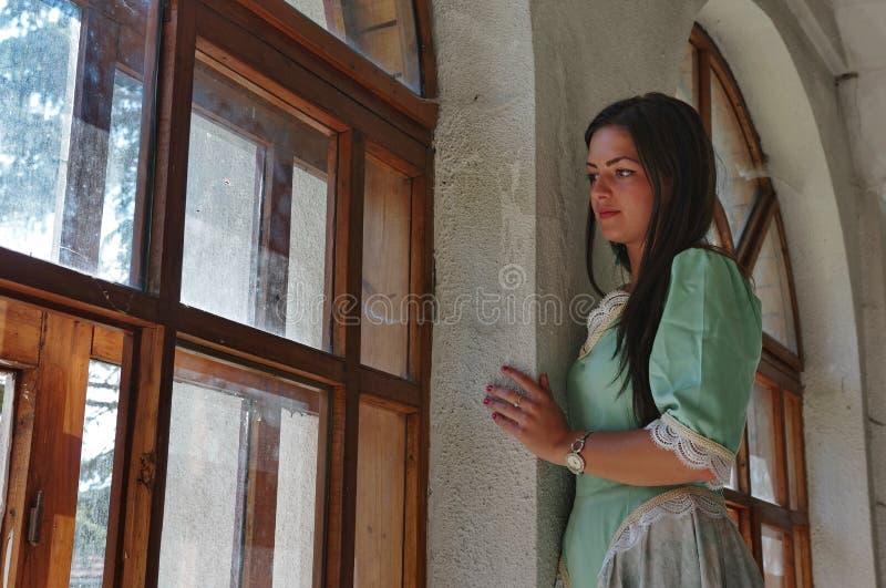 Kobieta przy okno zdjęcie stock