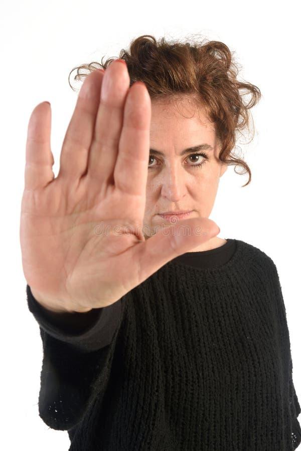 Kobieta robi przerwie z jej ręką zdjęcie stock