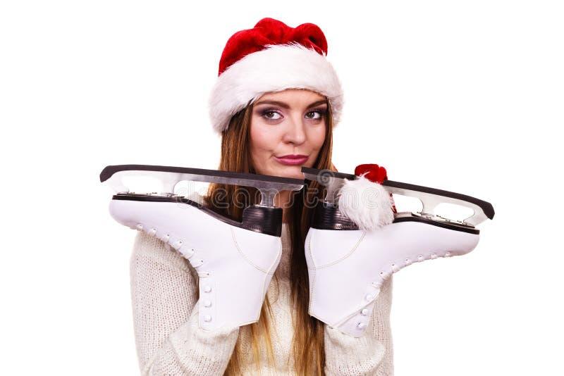 Kobieta Santa Claus z lodowymi łyżwami zdjęcia royalty free