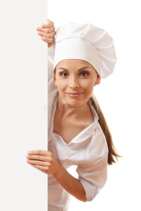 Kobieta szef kuchni, piekarz lub kucharz trzyma białego papieru znaka, fotografia stock