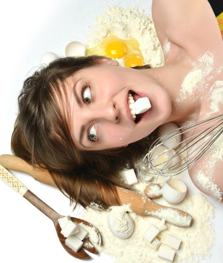 Kobieta szefa kuchni kuchnia wytłacza wzory kulinarnych wypiekowych cukrowych jajka pszenicznych zdjęcia stock