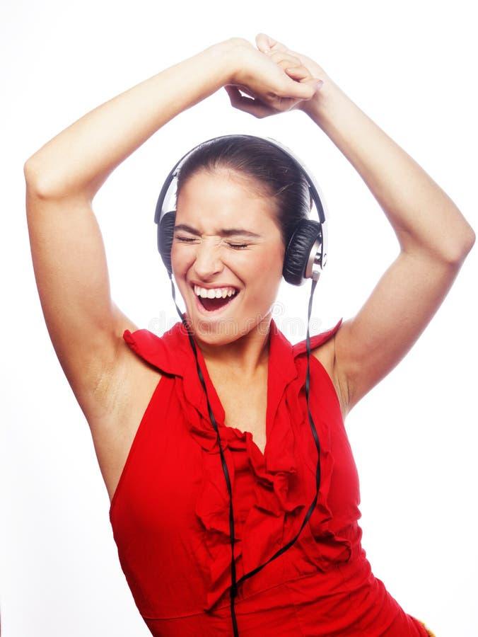 Kobieta tanczy muzyka z hełmofonami obrazy royalty free