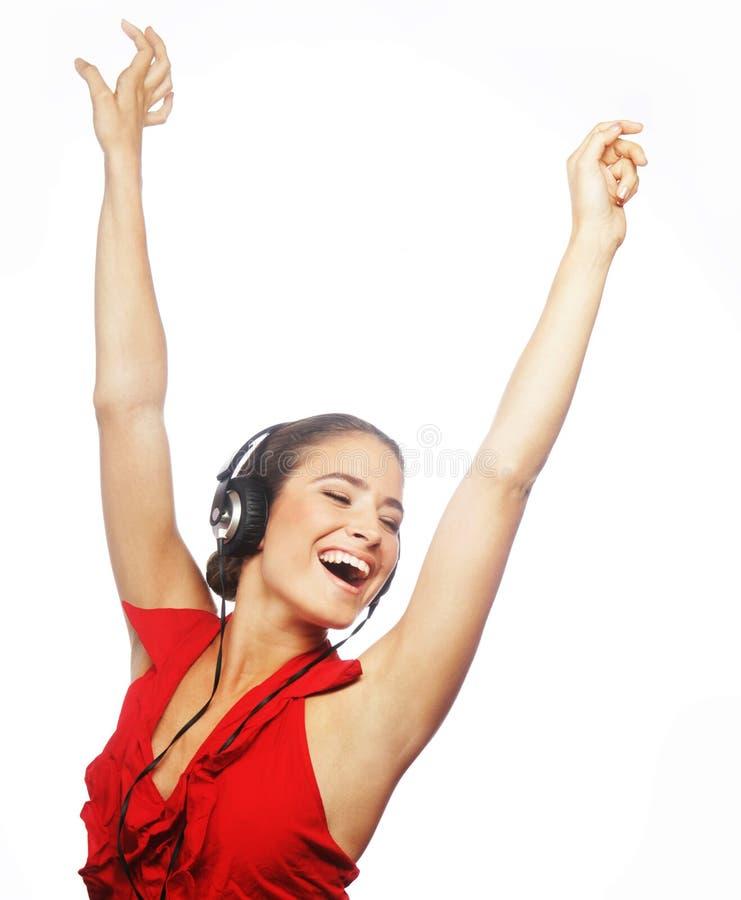 Kobieta tanczy muzyka z hełmofonami zdjęcia stock