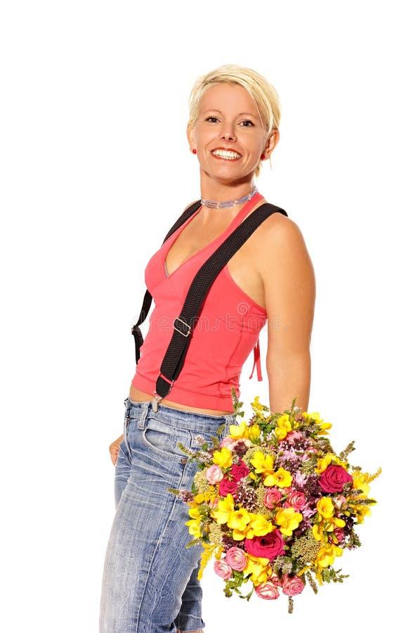 Kobieta trzyma bukiet kwiaty obraz stock