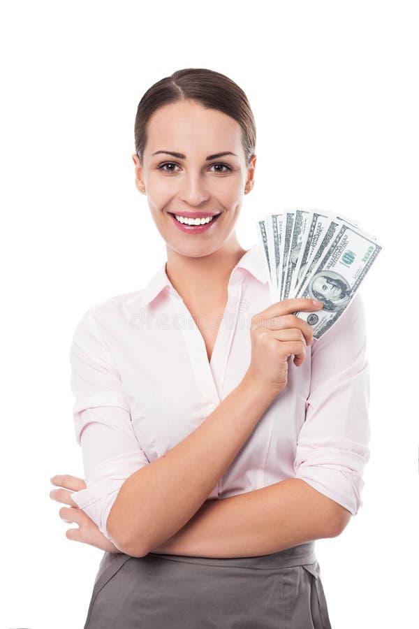 Kobieta trzyma fan pieniądze fotografia royalty free