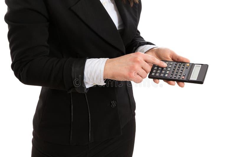 Kobieta trzyma odciskania i kalkulatora w kostiumu guzik fotografia stock