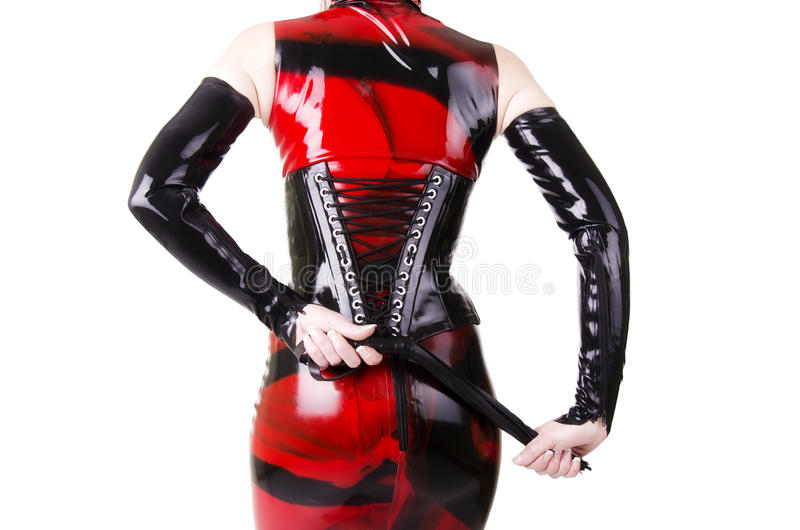 Kobieta ubierająca w dominatrix odziewa obraz royalty free